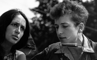 Bob Dylan plays harmonica with Joan Baez during his early days in New York