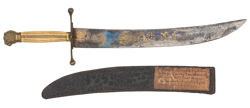 Crockett's knife, complete with its original scabbard and the period museum label