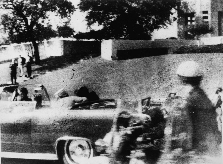The 'Moorman' photograph of the JFK assassination, with the original Grassy Knoll fence visible in the background