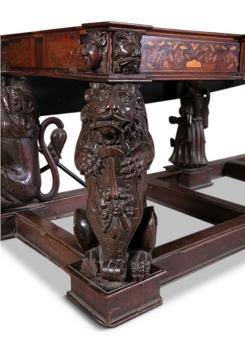 The table featured carvings of heraldic lions which were originally part of the ornamental woodwork of a Spanish galleon
