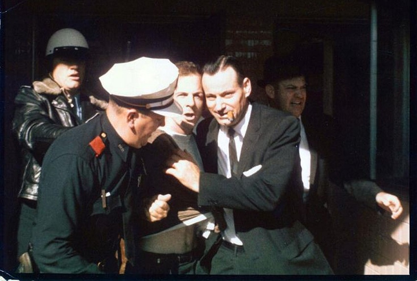 Lee Harvey Oswald being led from the Texas Theatre, following his arrest for the murder of officer J.D Tippet