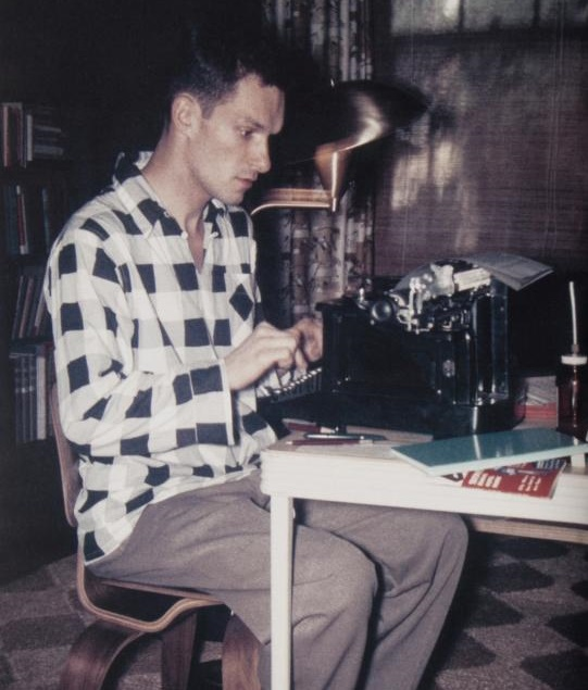 A young Hefner taps away on his Underwood typewriter