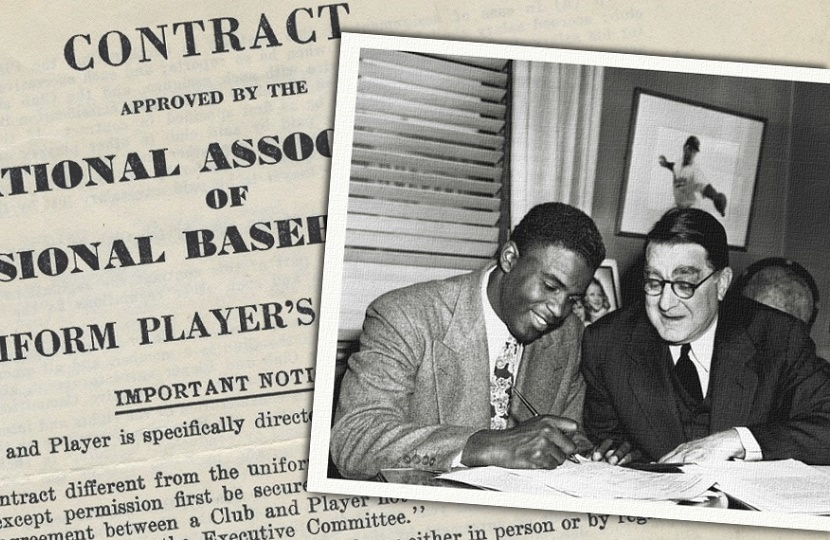 Jackie Robinson signing his historic baseball contract with the brooklyn dodgers