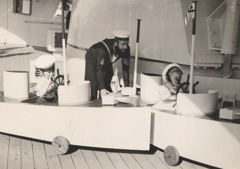 Prince Charles and Princess Anne as young children playing in toy boats
