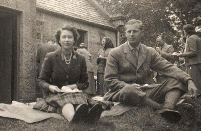 The unseen photos up for auction depict the Queen and the royal family in a relaxed setting