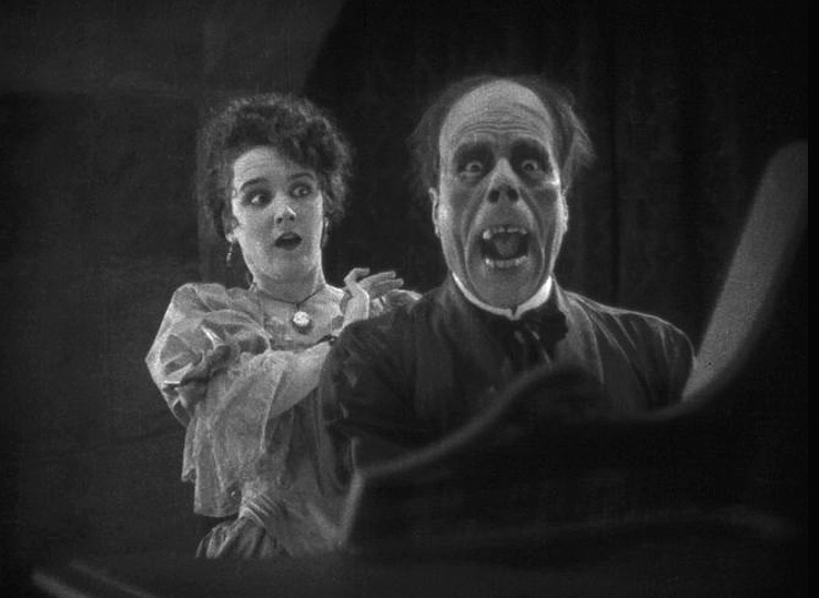 The reveal of Lon Chaney's Phantom is one of the most iconic moments in horror movie history