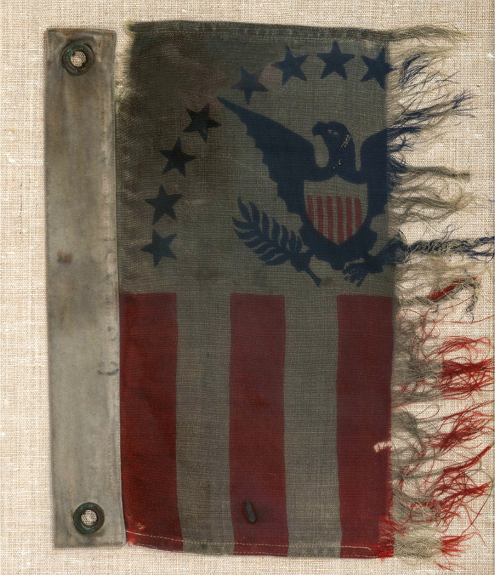The original USS LCI(L)-86 ensign flag flown during the Normandy Invasion