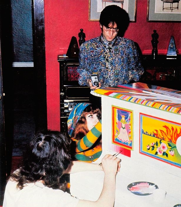 Lennon at his Kenwood home in 1967, with the Sgt Pepper piano seen behind him.