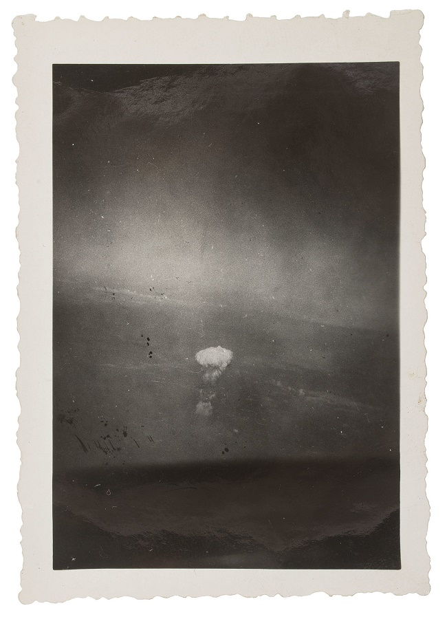 Gackenbach captured the mushroom cloud rising above the devastated city below