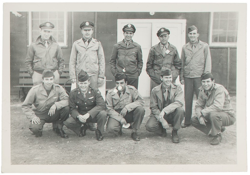 The crew of the B29 bomber Necessary Evil which took part in the bombing of Hiroshima. Lt. Russell E. Gackenbach pictured top row, center