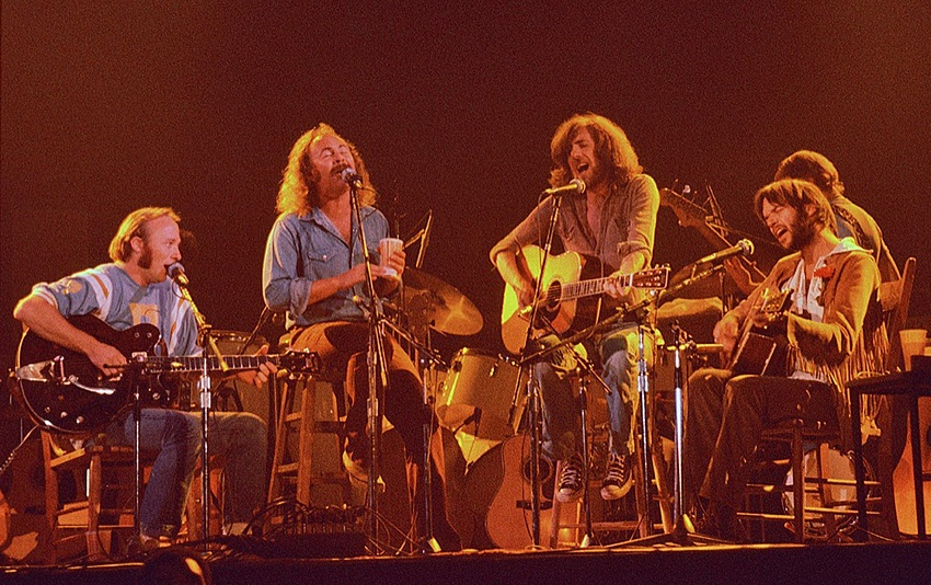Graham Nash (third right), playing his Martin accoustic guitar at the Woodstock Festival in 1969