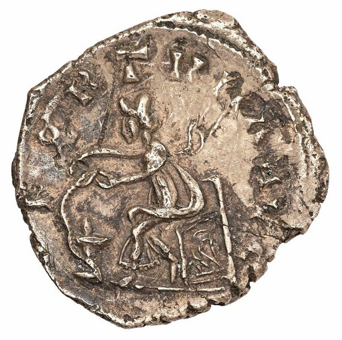 The reverse of the coin features an image of the Roman goddess Salus feeding a snake