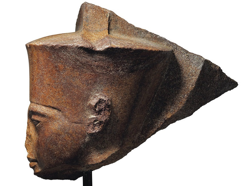 The sculpture is of the Ancient Egyptian God Amen, depicted with the features of the young Pharaoh Tutankhamen, circa 1333-1323 BC