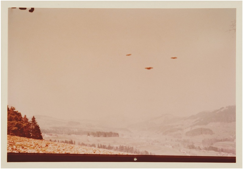 Billy Meier claims his photographs depict Plejaren 'beam ships' captured in the skies above rural Switzerland (Image: Sotheby's)