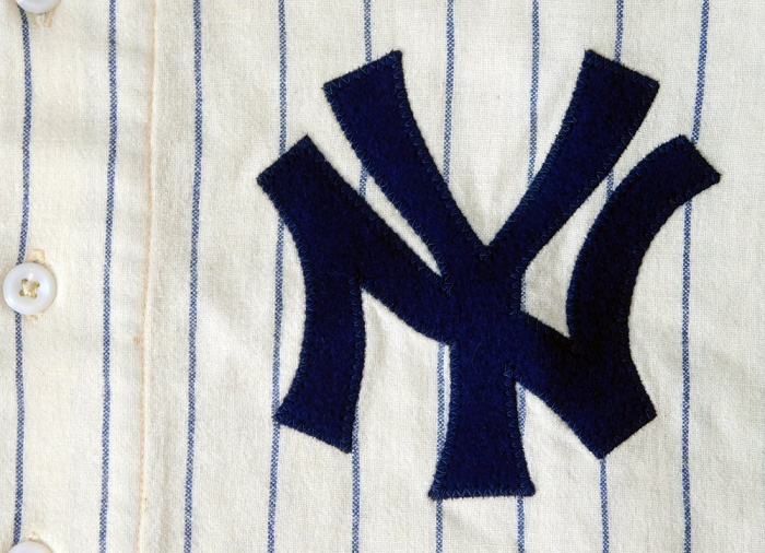 The hand-stitched Yankees 'NY' logo gives photo-matching experts 14 points with which to authenticate vintage jerseys (Image: Mile High Card Company)