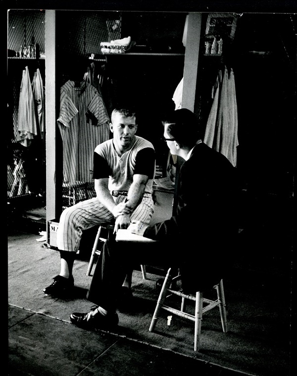 Mantle's jersey can be seen hanging in his locker behind him, in this famous photograph from the 1956 season (Image: Mile High Card Company)