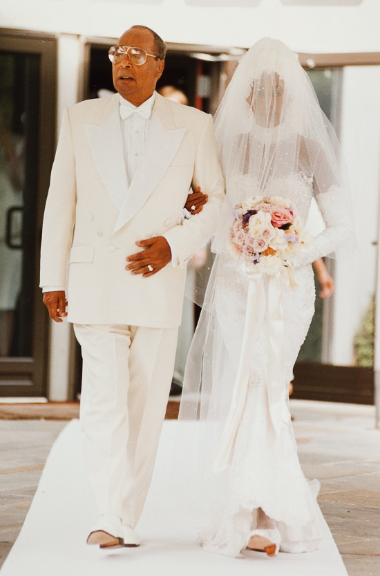 Whitney Houston walks down the aisle with her father John Houston, during her wedding to Bobby Brown on July 18, 1992 (Image: Heritage Auctions)